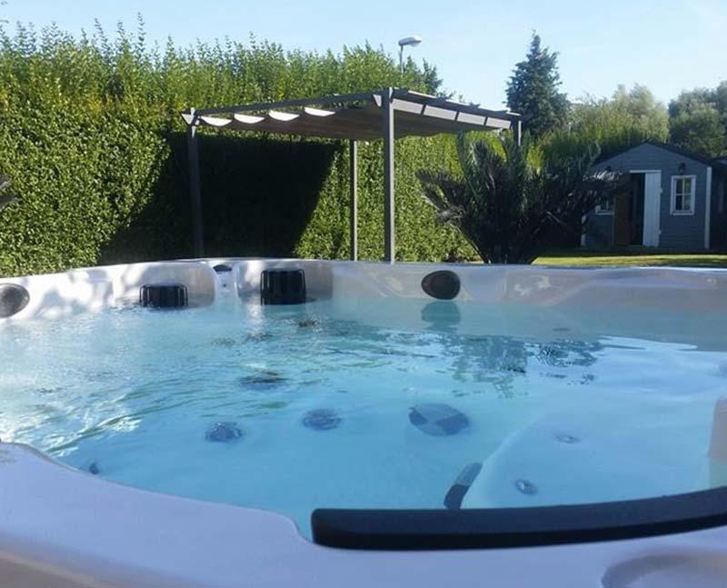 hot tub overlooking a backyard