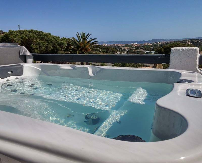 hot tub overlooking a coastal town