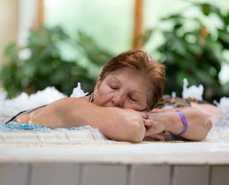 older woman sleeping in hot tub