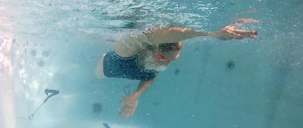 woman swimming in a swim spa