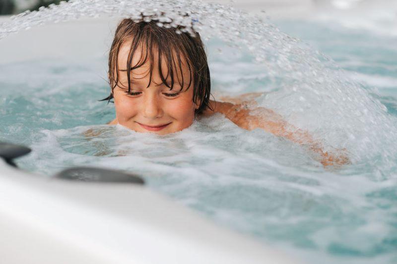little boy in hot tub