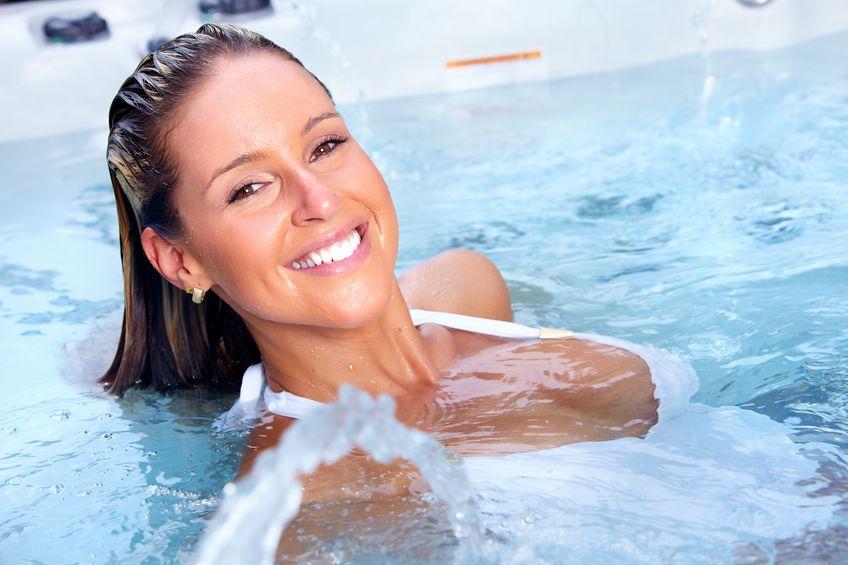 happy woman in hot tub